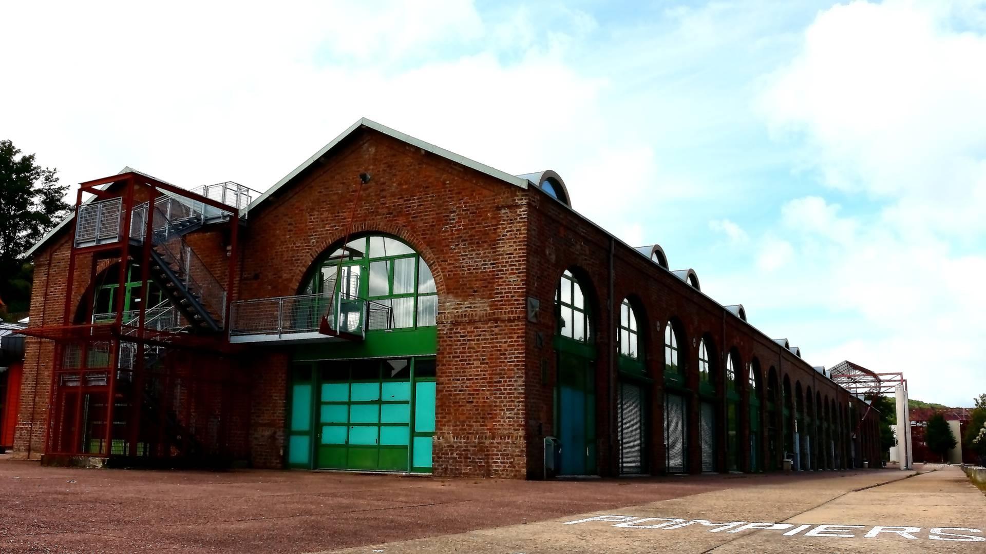 Anciens ateliers abritant le centre universitaire Condorcet, à l'emplacement de l'ancienne fonderie royale, Le Creusot. © Cyrille Dinant.
